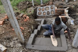 The Water Project: Indulusia Community, Wanyama Spring -  Plastering The Stairs