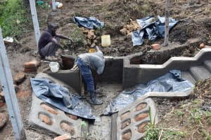 The Water Project: Indulusia Community, Wanyama Spring -  Plastering The Interior Walls