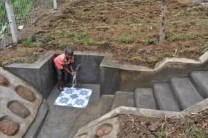 The Water Project: Indulusia Community, Wanyama Spring -  A Boy Enjoying Water