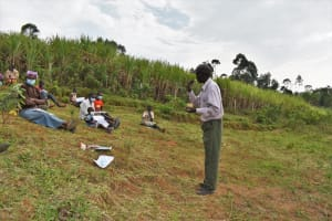 The Water Project: Indulusia Community, Wanyama Spring -  Demonstrating How To Brush Teeth