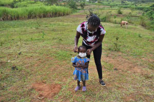 The Water Project: Indulusia Community, Wanyama Spring -  Demonstrating How To Help A Child Put On A Mask