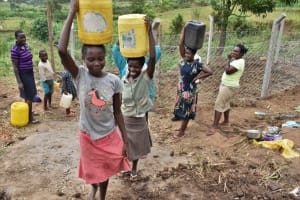 The Water Project: Indulusia Community, Wanyama Spring -  Women And Girls Carrying Water From The Spring