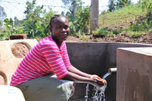 The Water Project: Indulusia Community, Wanyama Spring -  Enjoying The Flowing Water
