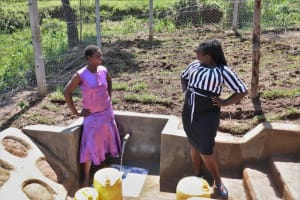 The Water Project: Indulusia Community, Wanyama Spring -  Striking A Pose With Director Catherine Chepkemoi