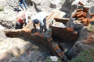 The Water Project: Muyundi Community, Magana Spring -  Wall Construction