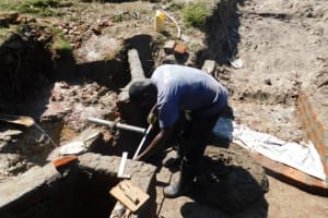 The Water Project: Muyundi Community, Magana Spring -  Discharge Pipe Measurement