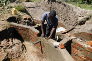 The Water Project: Muyundi Community, Magana Spring -  Discharge Pipe Setting
