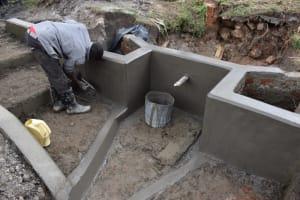 The Water Project: Muyundi Community, Magana Spring -  Plastering