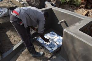 The Water Project: Muyundi Community, Magana Spring -  Tile Setting