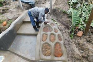 The Water Project: Muyundi Community, Magana Spring -  Setting Large Stones