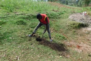 The Water Project: Muyundi Community, Magana Spring -  Digging Of Fencing Holes