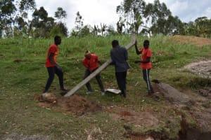 The Water Project: Muyundi Community, Magana Spring -  Erecting Fencing Poles