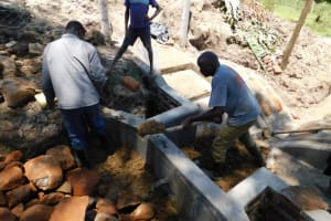 The Water Project: Muyundi Community, Magana Spring -  Backfilling With Clay