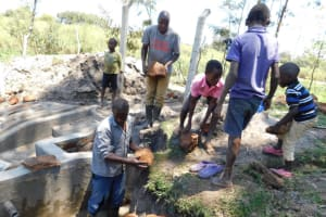 The Water Project: Muyundi Community, Magana Spring -  Backfilling With Large Stones