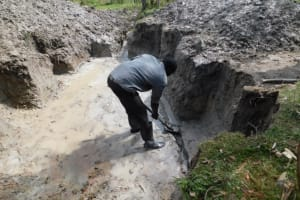 The Water Project: Muyundi Community, Magana Spring -  Digging Diversion Channels