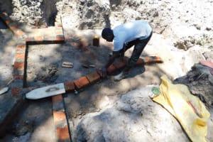 The Water Project: Muyundi Community, Magana Spring -  Building Walls