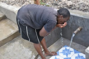 The Water Project: Muyundi Community, Magana Spring -  Catherine Having Fun Drinking Clean Water