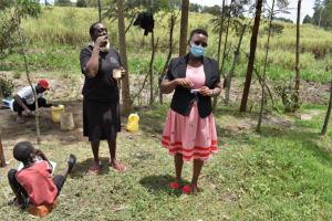 The Water Project: Muyundi Community, Magana Spring -  Cathy Demonstrating Toothbrushing