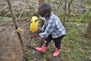 The Water Project: Muyundi Community, Magana Spring -  Ethan Washing Hands