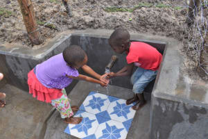 The Water Project: Muyundi Community, Magana Spring -  Gift And Ivy Having Fun With Water
