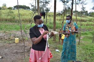 The Water Project: Muyundi Community, Magana Spring -  Making Masks With Local Materials