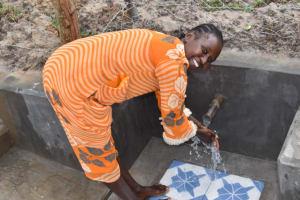 The Water Project: Muyundi Community, Magana Spring -  Pretempta Mukotsi Enjoys Water