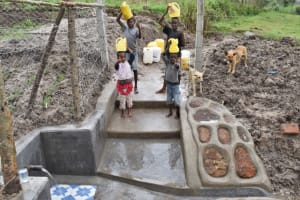 The Water Project: Muyundi Community, Magana Spring -  Children Excited To Fetch And Ferry Home Clean And Safe Water