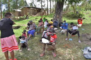 The Water Project: Muyundi Community, Magana Spring -  Demonstrating Coughing In Elbow