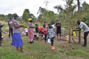 The Water Project: Muyundi Community, Magana Spring -  Demonstrating Proper Handwashing