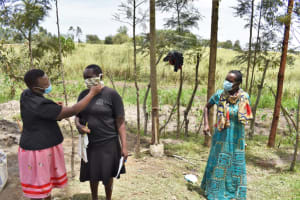 The Water Project: Muyundi Community, Magana Spring -  Demonstrating Wearing A Mask Properly