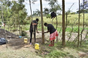 The Water Project: Muyundi Community, Magana Spring -  Demonstration On How To Make A Tippy Tap