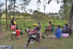 The Water Project: Muyundi Community, Magana Spring -  Discussion On The Usage Of Leaky Tin To Wash Hands Well