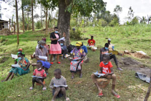 The Water Project: Muyundi Community, Magana Spring -  Distribution Of Handouts To Participants