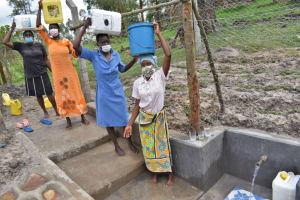 The Water Project: Muyundi Community, Magana Spring -  Women Fetching Water