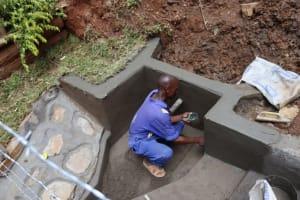 The Water Project: Shamakhokho Community, Wizula Spring -  Plastering