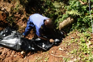 The Water Project: Shamakhokho Community, Wizula Spring -  Backfilling With Thick Plastic Tarp