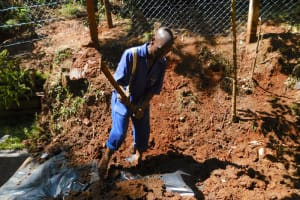 The Water Project: Shamakhokho Community, Wizula Spring -  Backfilling With Soil