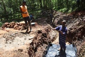 The Water Project: Shamakhokho Community, Wizula Spring -  Artisan Setting The Slab