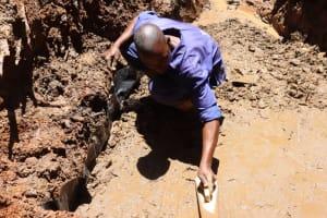 The Water Project: Shamakhokho Community, Wizula Spring -  Artisan Setting Foundation Slab