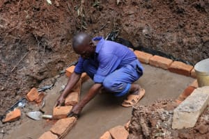 The Water Project: Shamakhokho Community, Wizula Spring -  Artisan Setting Bricks
