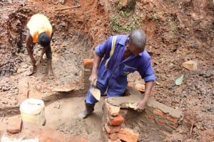 The Water Project: Shamakhokho Community, Wizula Spring -  Artisan Constructing Walls