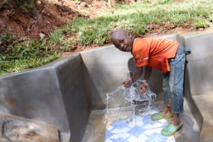 The Water Project: Shamakhokho Community, Wizula Spring -  A Boy Playing With Water