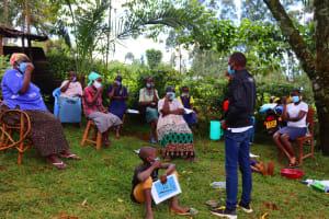 The Water Project: Shamakhokho Community, Wizula Spring -  Facilitator Engaging Participants On Dental Hygiene