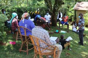 The Water Project: Shamakhokho Community, Wizula Spring -  Facilitator Teaching Safe Water Handling
