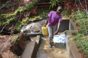 The Water Project: Shamakhokho Community, Wizula Spring -  Faith Carrying Water Home