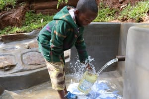 The Water Project: Shamakhokho Community, Wizula Spring -  Fetching Water With Ease