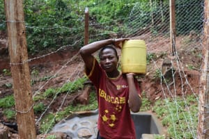 The Water Project: Shamakhokho Community, Wizula Spring -  Taking Clean Water Home