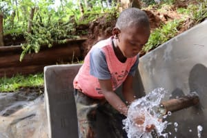The Water Project: Shamakhokho Community, Wizula Spring -  Young Boy Playing With Water