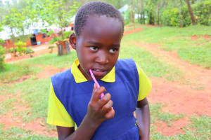 The Water Project: Shamakhokho Community, Wizula Spring -  Young Girl Demonstrating Toothbrushing