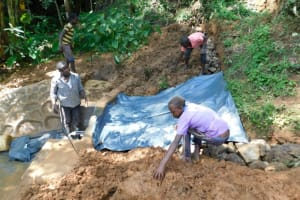 The Water Project: Malekha West Community, Soita Spring -  Plastic Sheeting